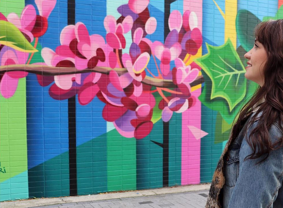 Stephanie Boutari viewing a mural