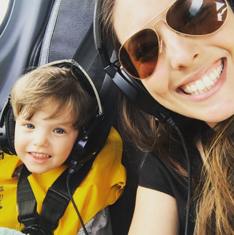 Nicole and her son wearing headphones