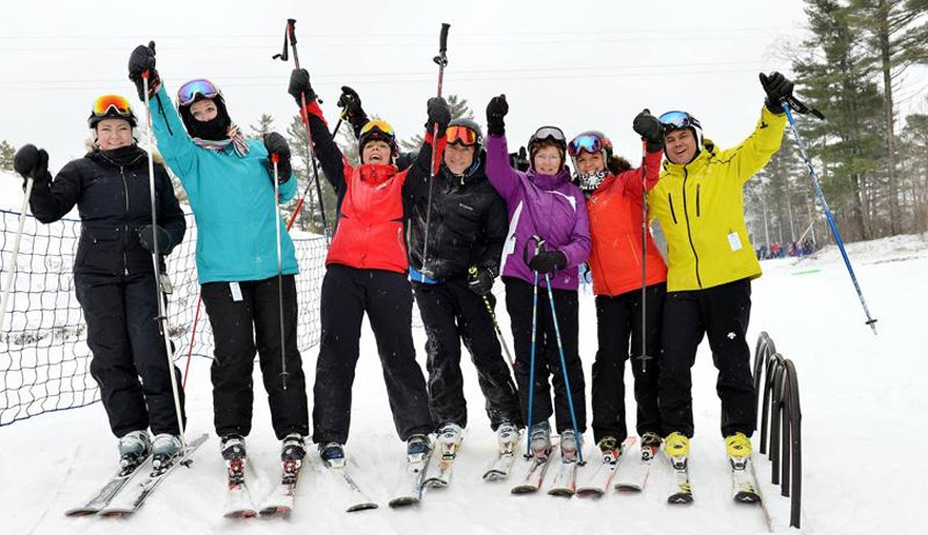 skiers celebrating and having fun on the slopes